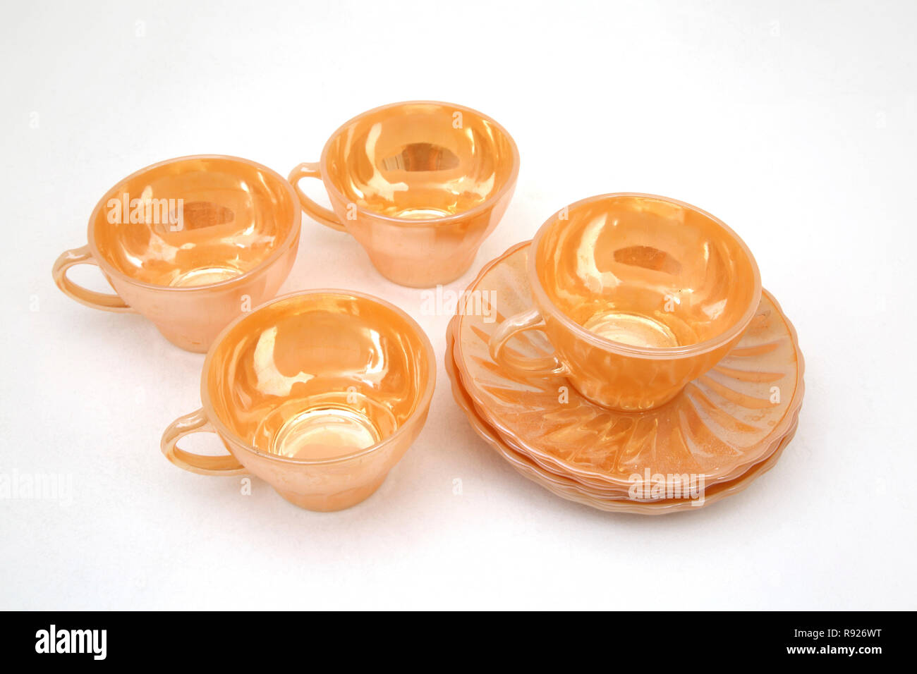 Vintage 1950's Anchor Hocking Fire King Swirl  Peach Lustre 4 Cups  & 4 Saucers American  USA - Stock Image