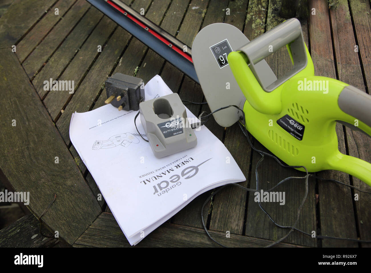 Garden Gear Cordless Hedge Trimmer Charger and User Manual Stock Photo