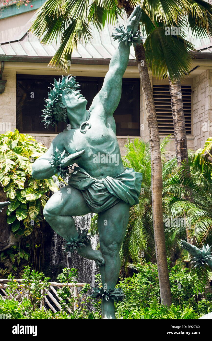Waikiki, Hawaii - 25 May 2016: Close up image of the male statue outside the Hilton Hawaiian Village by commissioned artist Kim Duffet. Kaha Ka `Io Me - Stock Image