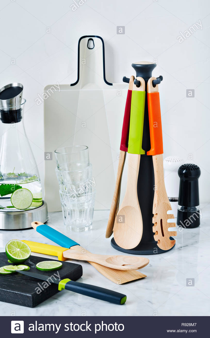 kitchen utensils and carafe with lime water - Stock Image