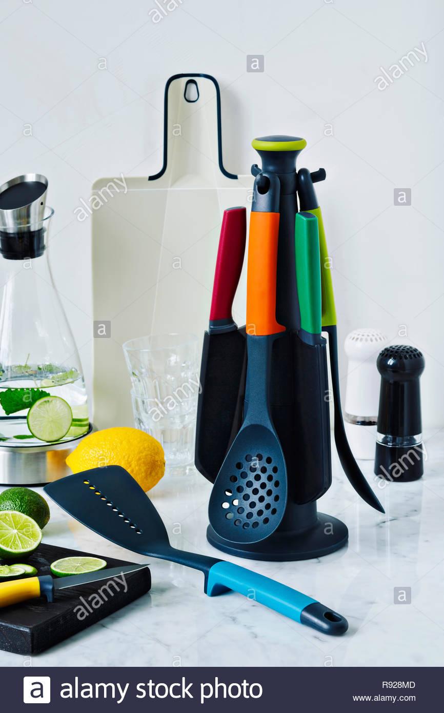 Still-life shot with kitchen utensils, lemons amd limes - Stock Image