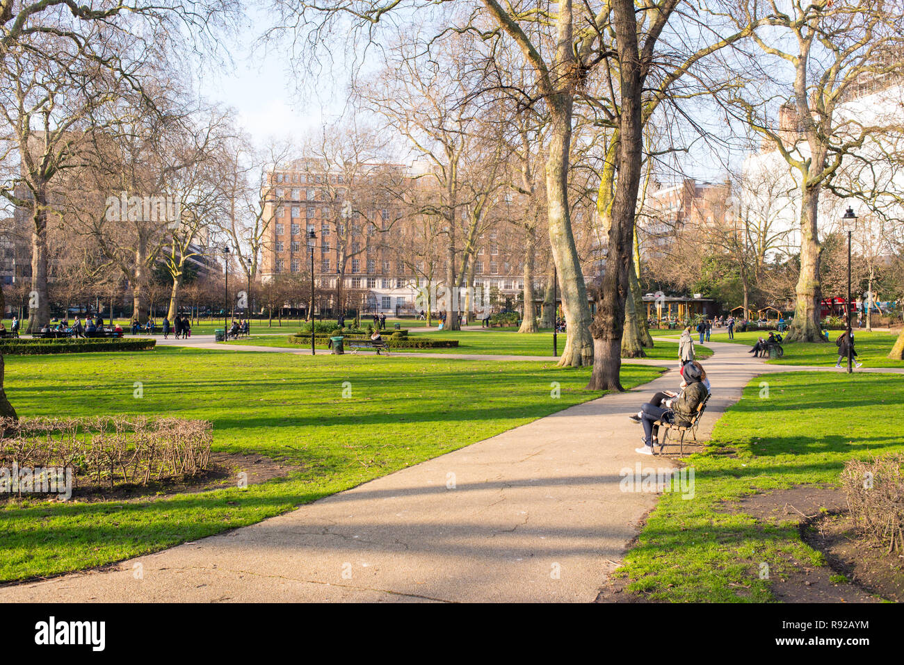 Russell Square, London, UK - February 2017. People in Russell Square, a large garden square in Bloomsbury, in the London Borough of Camden Stock Photo
