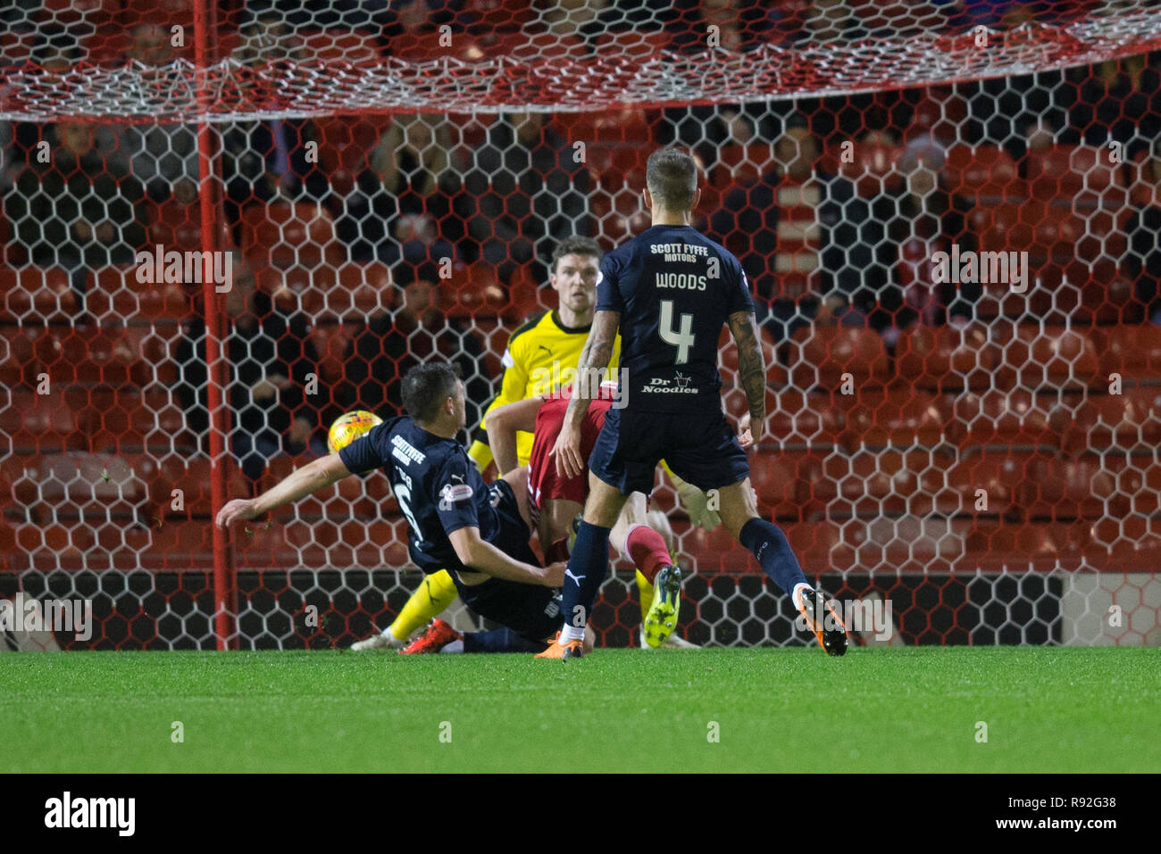 Pittodrie Stadium, Aberdeen, UK. 18th Dec, 2018. Ladbrokes Premiership football, Aberdeen versus Dundee; Sam Cosgrove of Aberdeen shoots and scores for 1-0 in the 15th minute Credit: Action Plus Sports/Alamy Live News - Stock Image