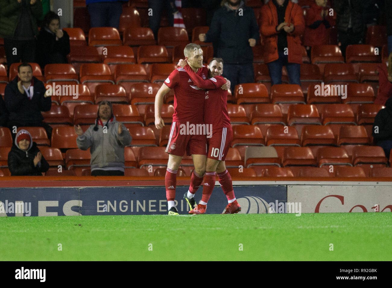 Pittodrie Stadium, Aberdeen, UK. 18th Dec, 2018. Ladbrokes Premiership football, Aberdeen versus Dundee; Sam Cosgrove of Aberdeen is congratulated after scoring for 2-0 by Niall McGinn Credit: Action Plus Sports/Alamy Live News - Stock Image