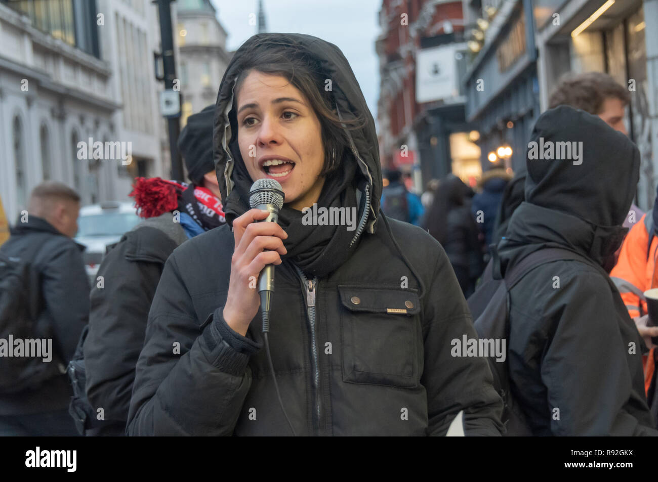 """London, UK. 18th December 2018. A speaker from Berlin community centre and pub Syndikat at the protest with London Renters Union outside the London offices of their landlord, Global Real Estate Investors Limited, owned by the secretive Pears brothers, three of the richest men in the UK, who through various """"letterbox"""" companies own around 6200 properties in Berlin, against notice to quit after being open for 33 years in Berlin-Neukölln. Credit: Peter Marshall/Alamy Live News Stock Photo"""