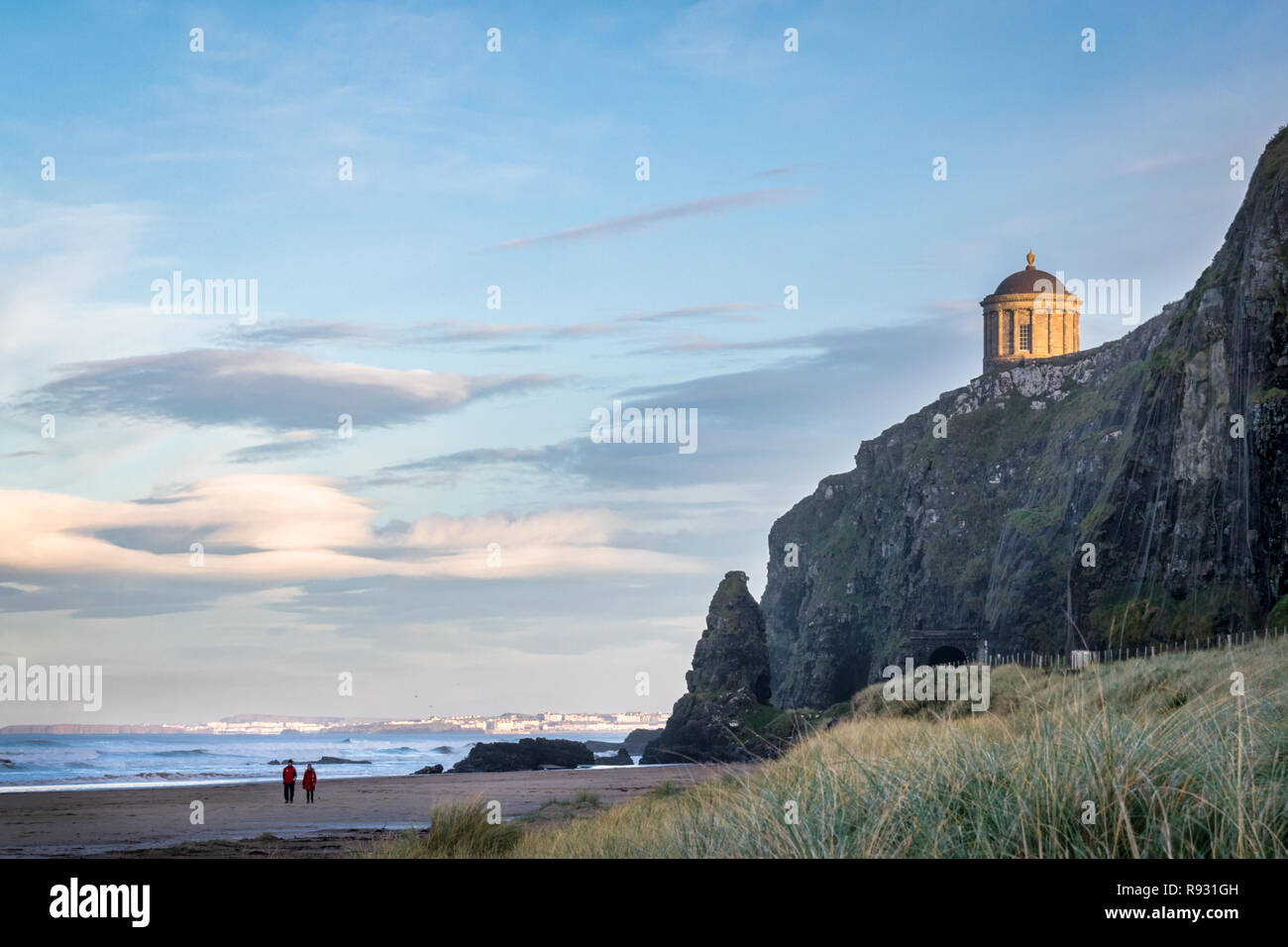 This is a picture of the railtracks that run along the Antrim Coast.  In the distance you can see Mussenden Temple on the edge of the cliff - Stock Image