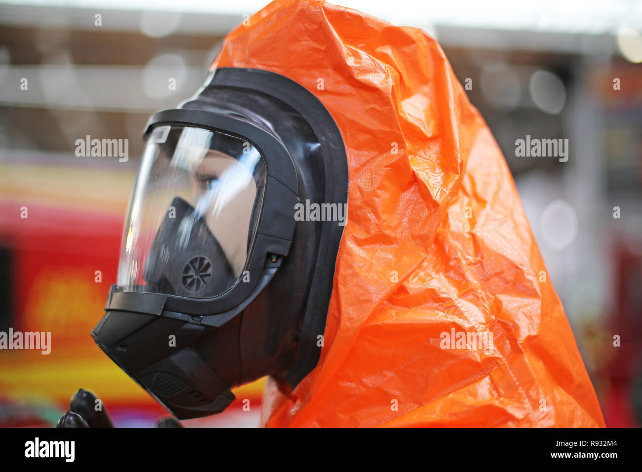 protective clothing with gas mask - Stock Image