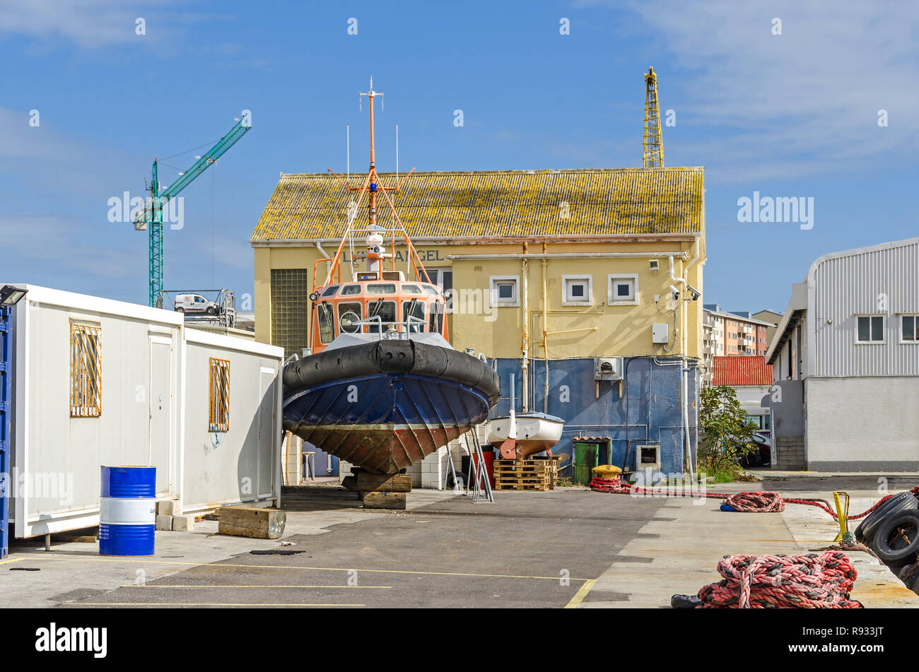 Gibraltar, British Overseas Territory -  November 8, 2018: Harbor with a towboat, old port building and cranes - Stock Image