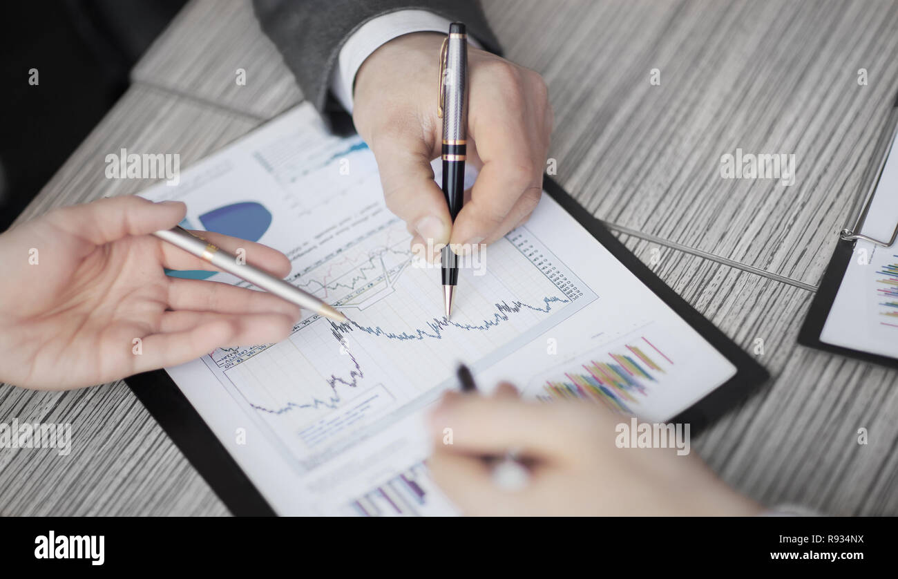 Graphical analysis graph which lies on the Desk in the office - Stock Image