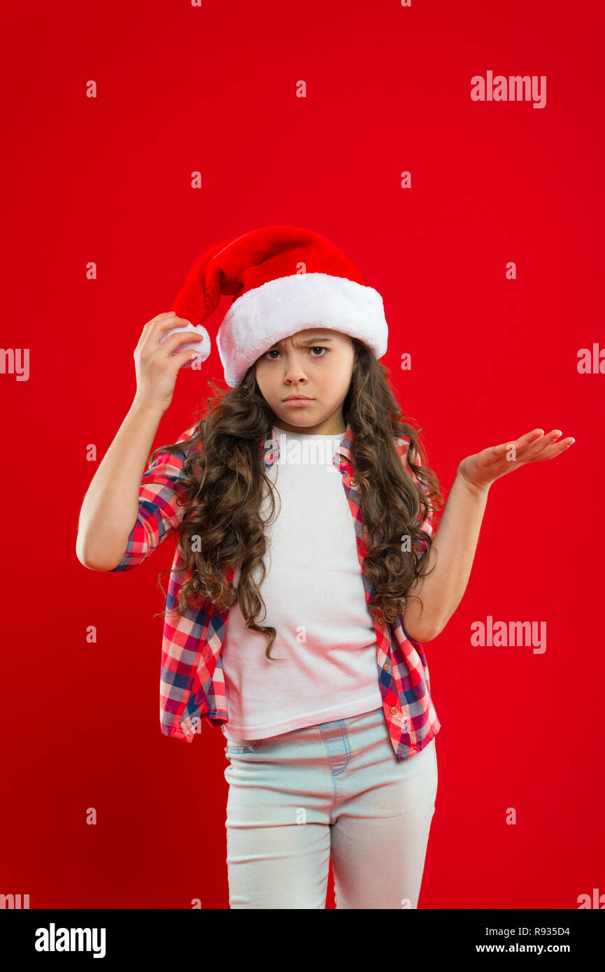 47f4fa4d631 Santa claus kid. Christmas shopping. Happy winter holidays. Small upset  girl. Little girl child in santa hat. The best present.