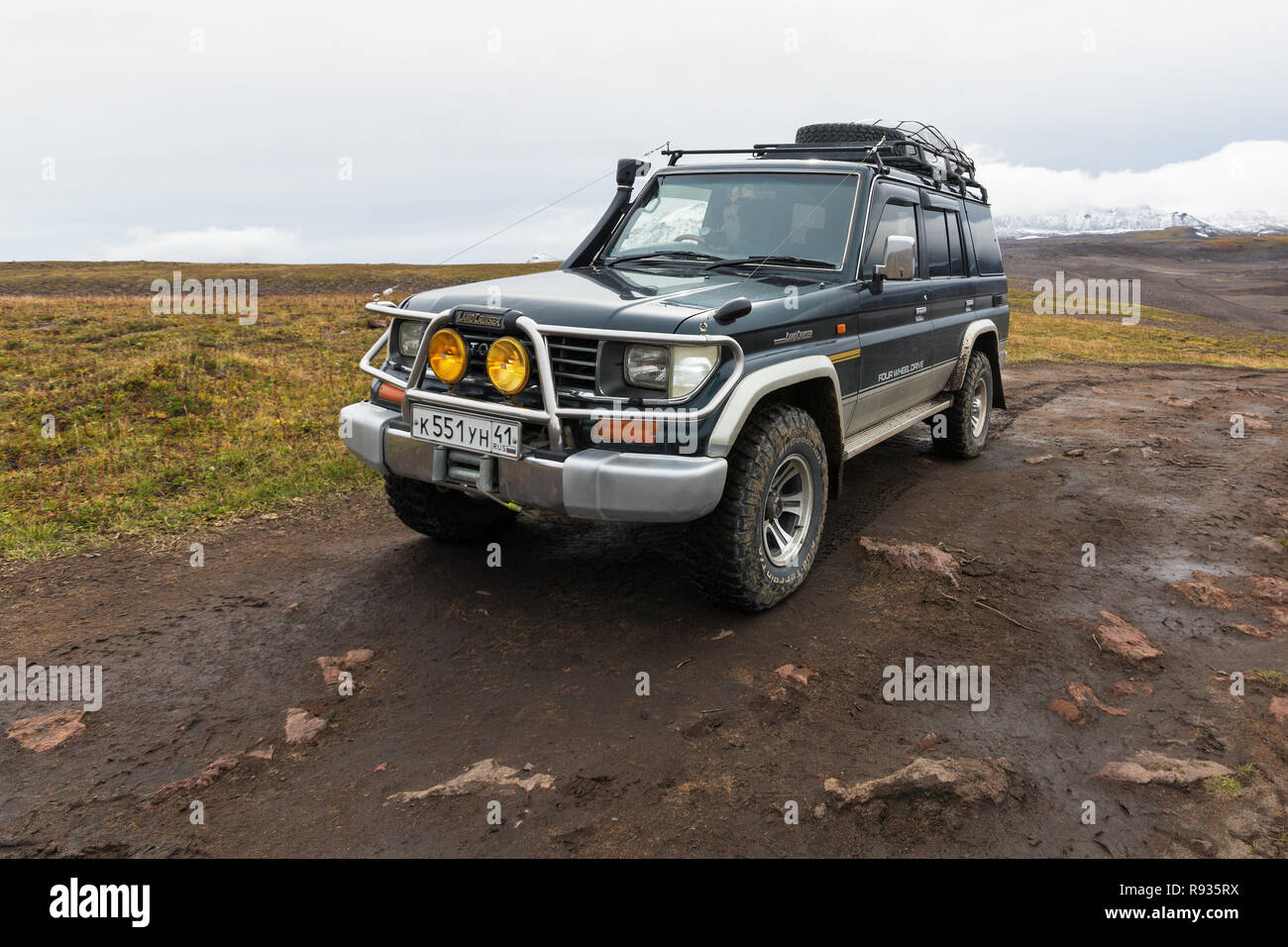 Extreme off-road expedition automobile Toyota Land Cruiser Prado (70 series) parked on mount road - Stock Image