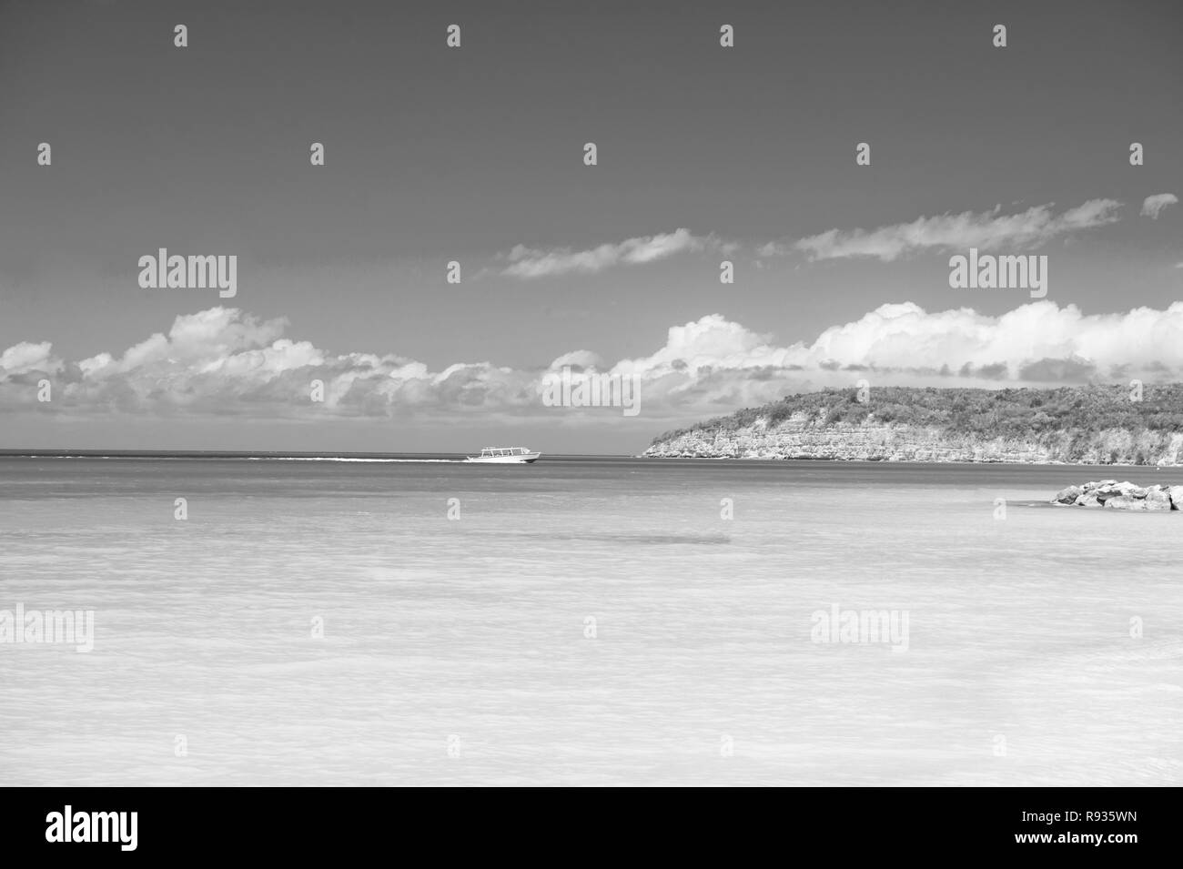 Sky with clouds over calm sea beach tropical resort. Boat touristic ship in turquoise ocean lagoon. Tourist attraction. Travel touristic boat tranquil lagoon. Sea excursion for holidaymakers. Stock Photo