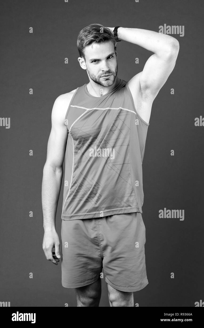 Sportsman after training feel pleasant aroma. Guy check armpit dry skin. Prevent or reduce perspiration. Choose proper antiperspirant or deodorant for training. Man satisfied his antiperspirant. - Stock Image