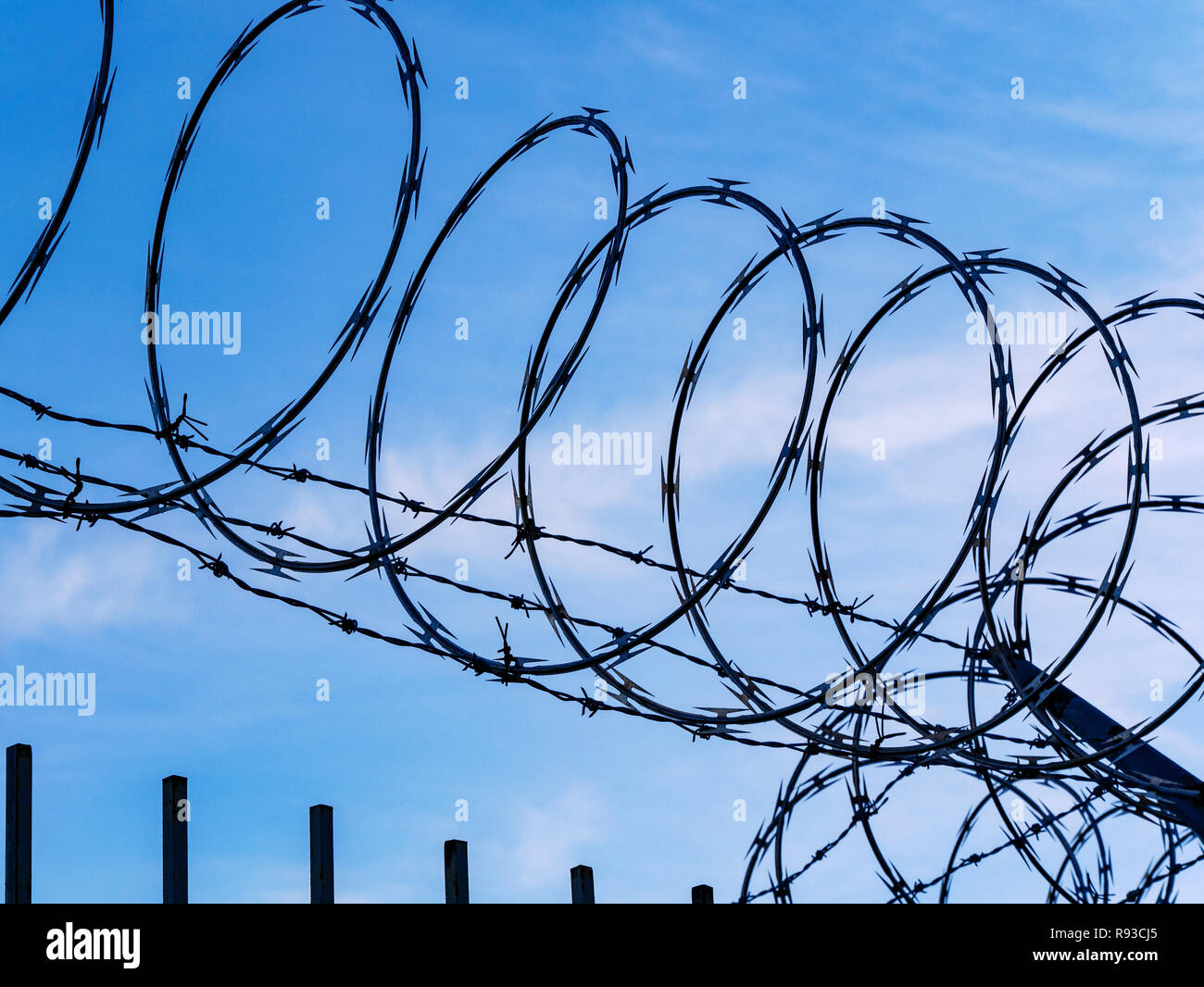 Coil Helix Stock Photos Images Alamy Rj22 Jack Wiring Diagram Razor Wire Against Blue Sky And Clouds Image