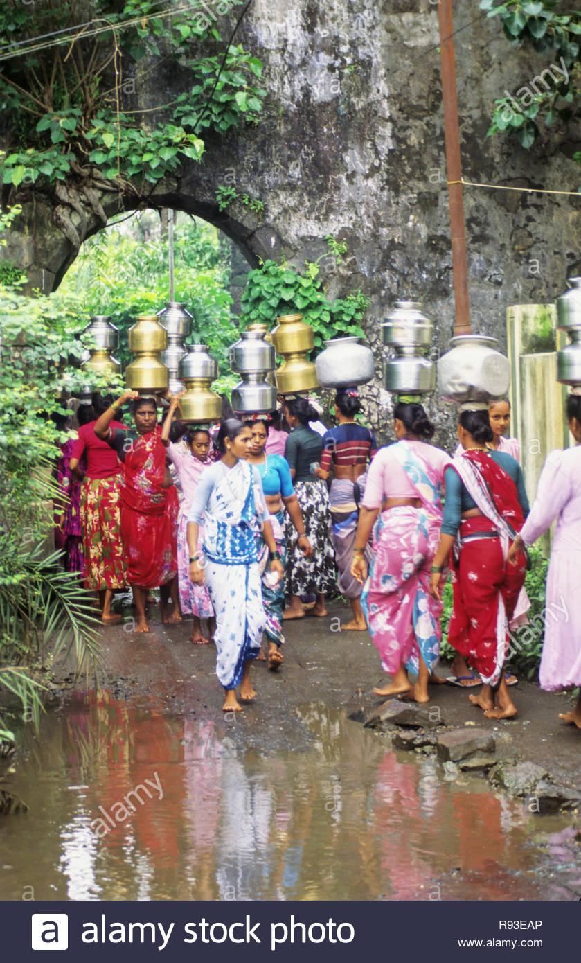 village women caring water pots, india - Stock Image