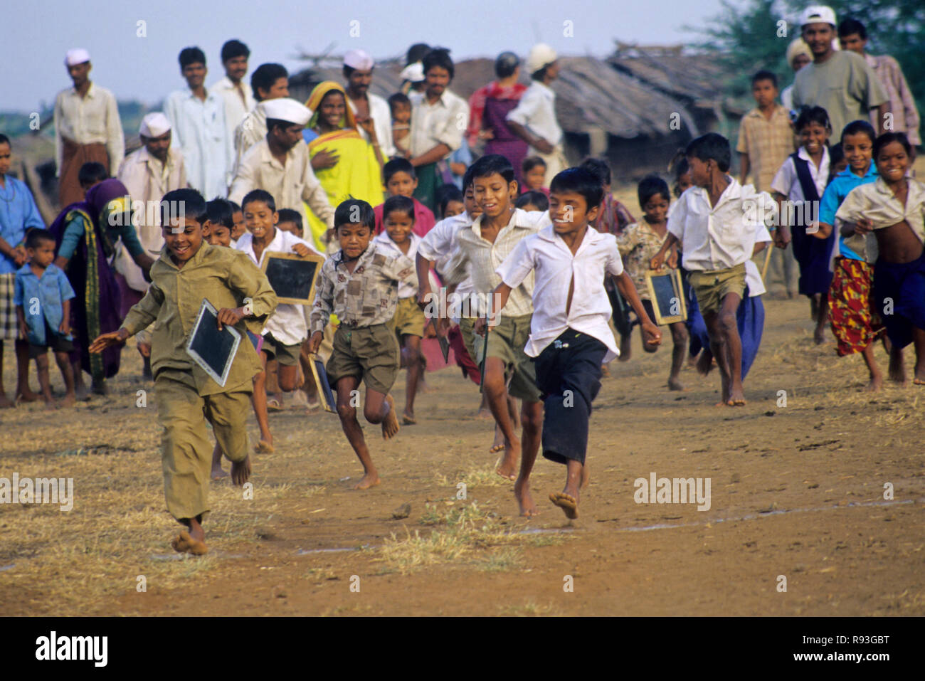 children running from school, kala pani, dhule, maharashtra, india - Stock Image
