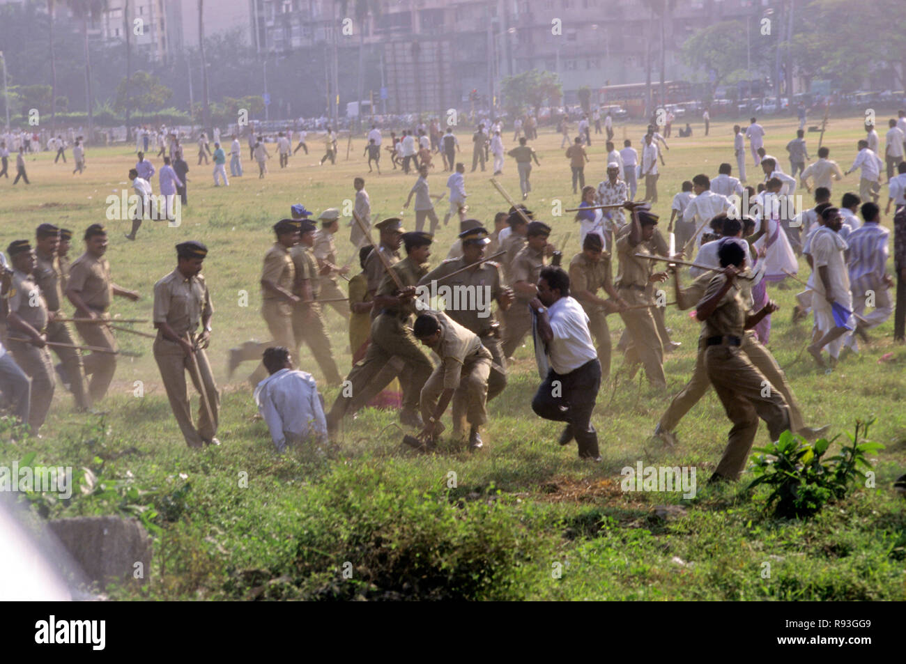 police controlling riot situation, india - Stock Image