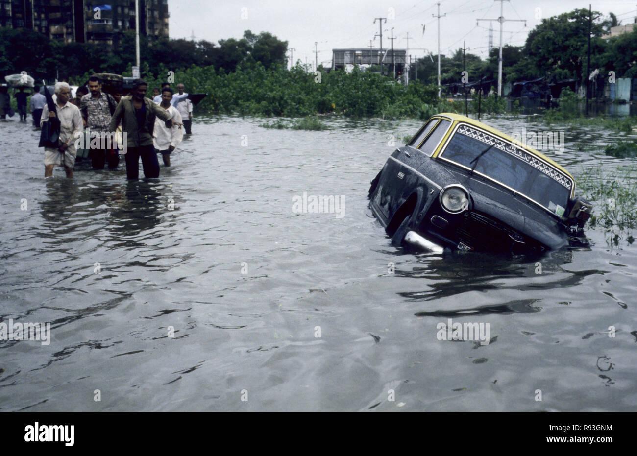 Taxi submerged in rain water flooding street in monsoon season Bombay Mumbai Maharashtra India Stock Photo