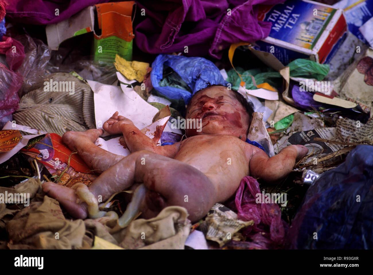 child killed and left in dustbin, bombay mumbai, maharashtra, india - Stock Image