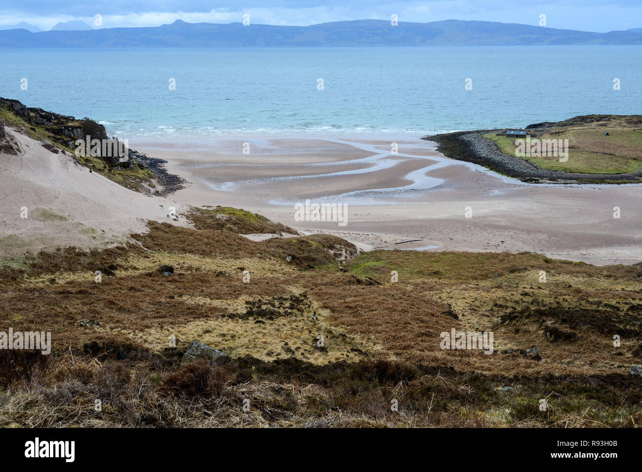 Sandy beach with distant view of Raasay and Isle of Skye, Applecross Peninsula, Wester Ross, Highland Region, Scotland - Stock Image