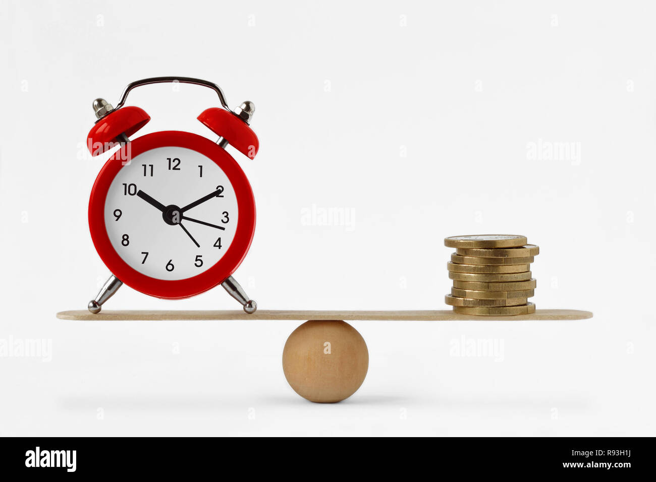 Clock and money on scales - Balance between time and money, time is money concept - Stock Image