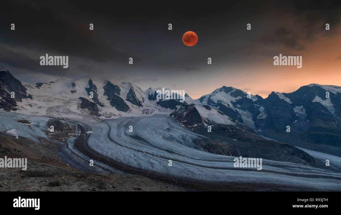 Panoramic view of the Bernina Group with blood moon, Piz Palü, Bellavista, Crast Agüzza, Piz Bernina, Piz Morteratsch - Stock Image