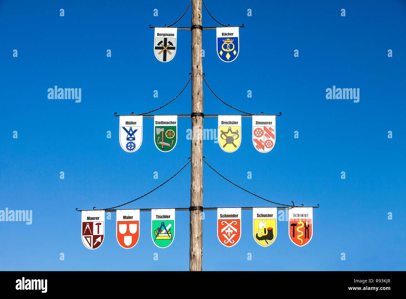 Guild pole with the emblems of all the trades of the town, Niedersorpe, Sauerland, North Rhine-Westphalia - Stock Image