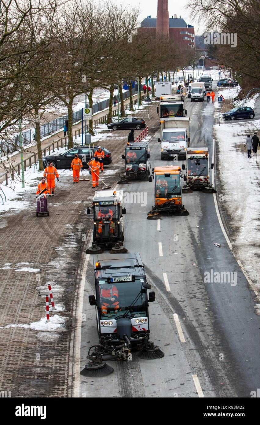 Street cleaning, municipal cleaning workers cleaning a street after a carnival parade, Essen, North Rhine-Westphalia, Germany Stock Photo