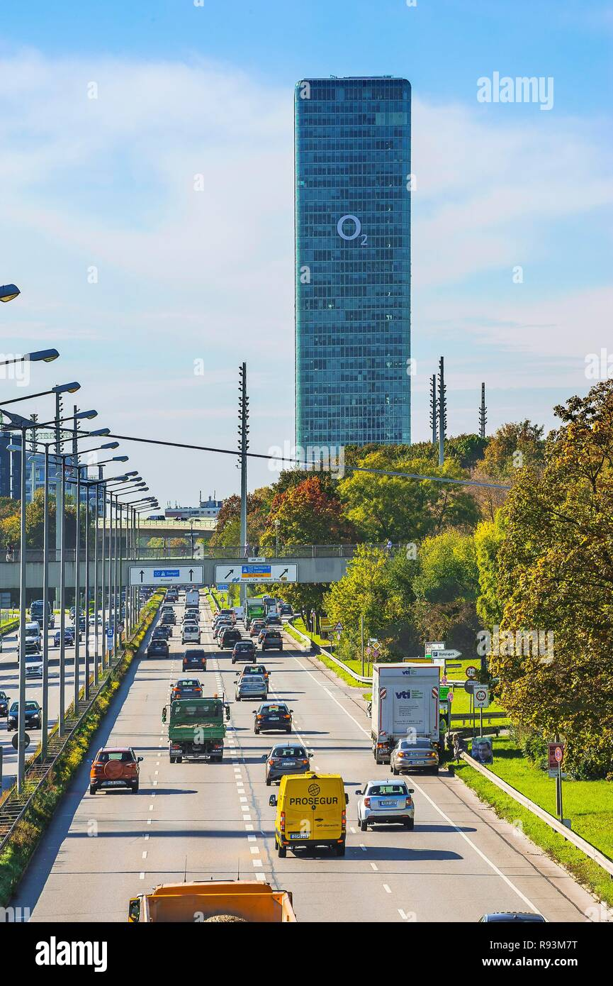 Road traffic at Georg-Brauchle-Ring with O2 tower, Munich, Upper Bavaria, Bavaria, Germany - Stock Image