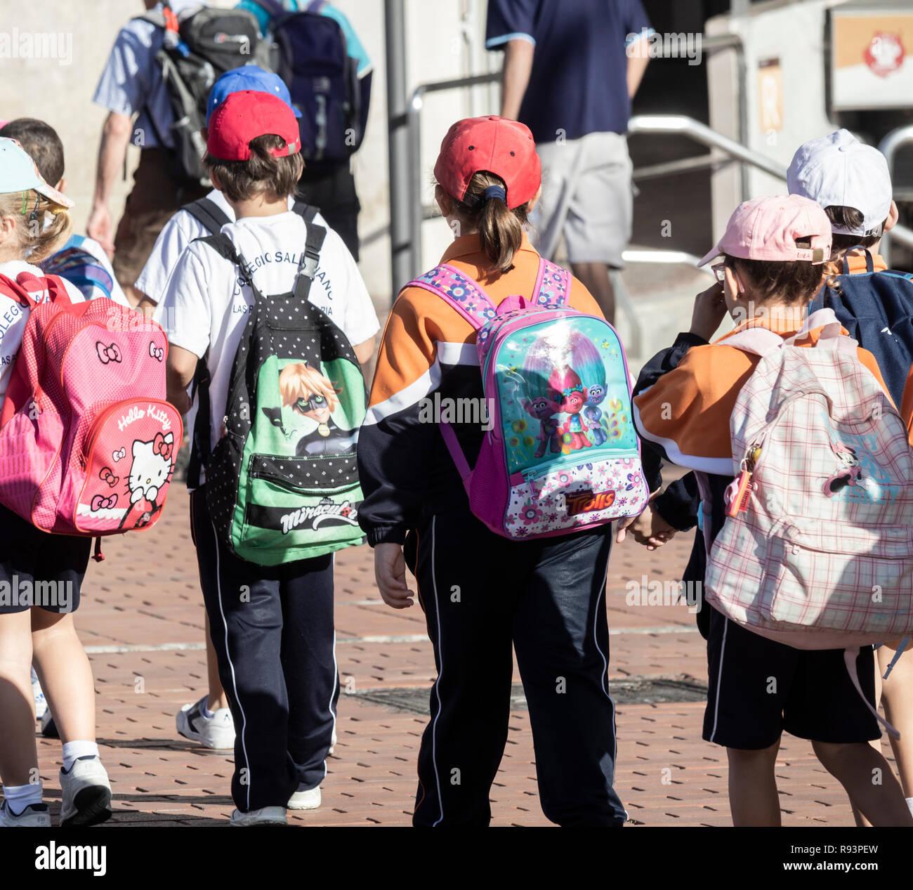 Spanish schoolchildren with large backpacks - Stock Image