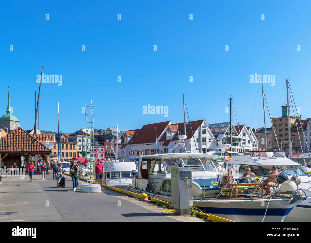 Cabin cruisers and yachts in Vagen harbour, Bergen, Hordaland, Norway - Stock Image