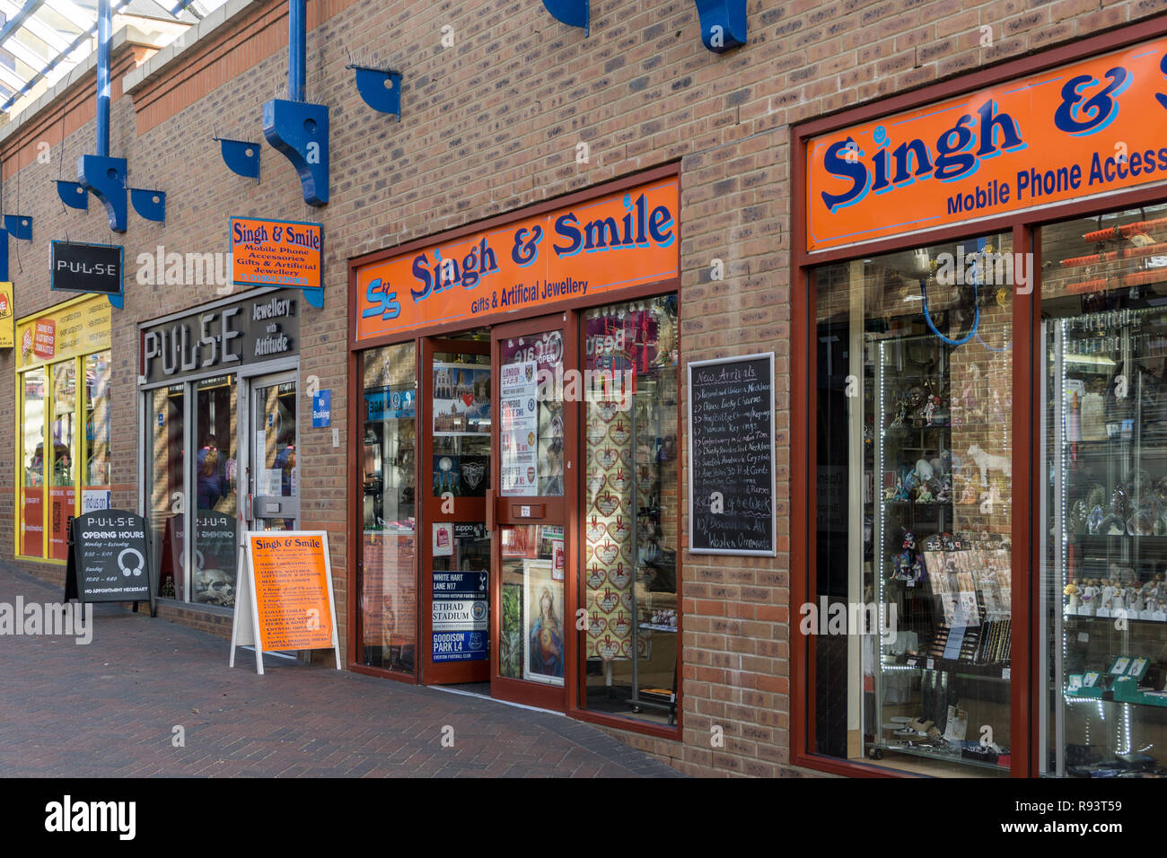 Singh & Smile, a humorous name for a shop selling gifts and artificial jewelry, Northampton, UK - Stock Image