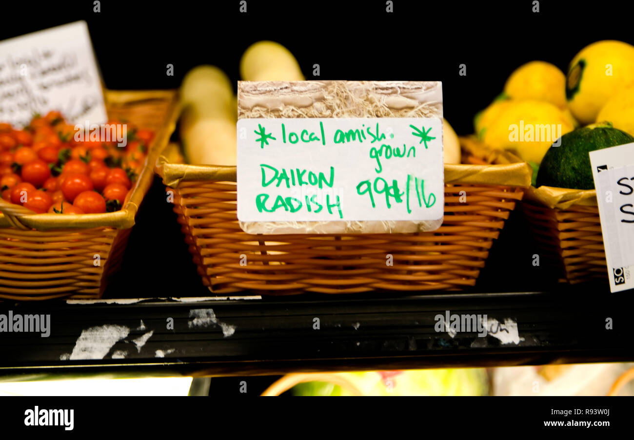 Daikon radish, grown locally by Amish farmers, is one of the items sold at B.T.C. Old-Fashioned Grocery in Water Valley, Mississippi. Stock Photo