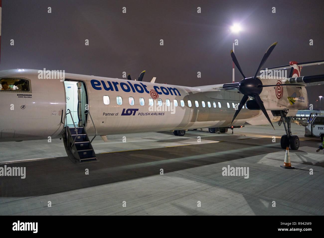 WARSAW, POLAND - CIRCA NOVEMBER, 2017:  Eurolot Bombardier Q400 NextGen at Warsaw Chopin Airport. Stock Photo