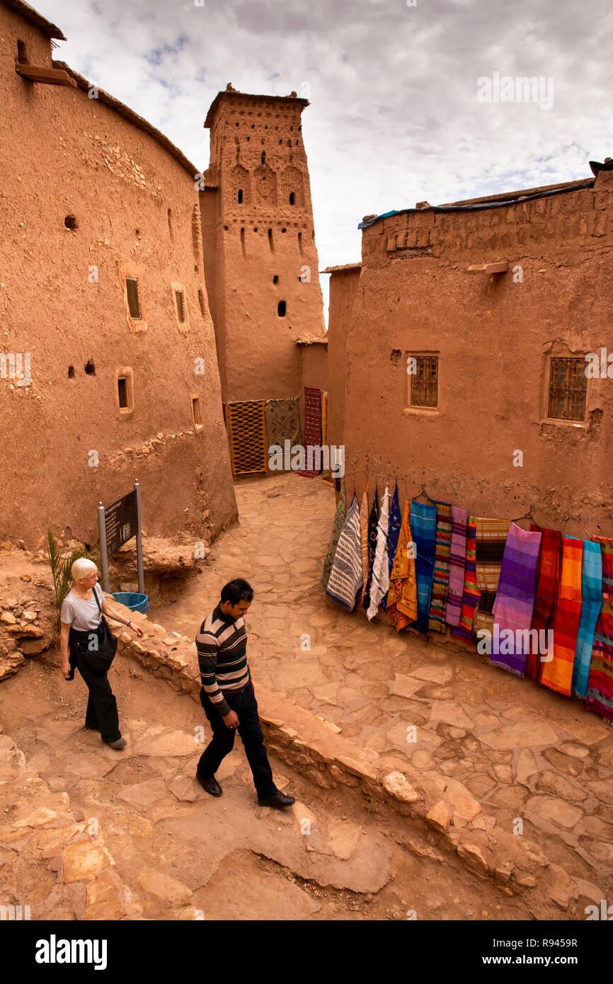 Morocco, Ouarzazate, Ksar of Ait-Ben-Haddou, guide and western tourist walking through Kasbah - Stock Image