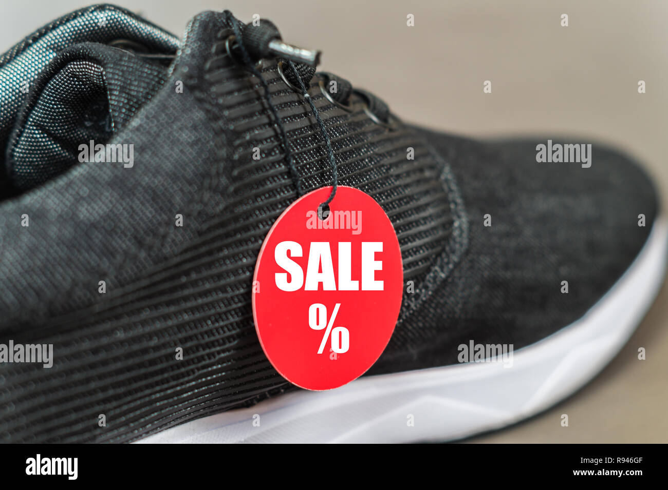 ec8032b98bc9 Close up new sportshoes. Men sneaker with red sale sign Stock Photo ...