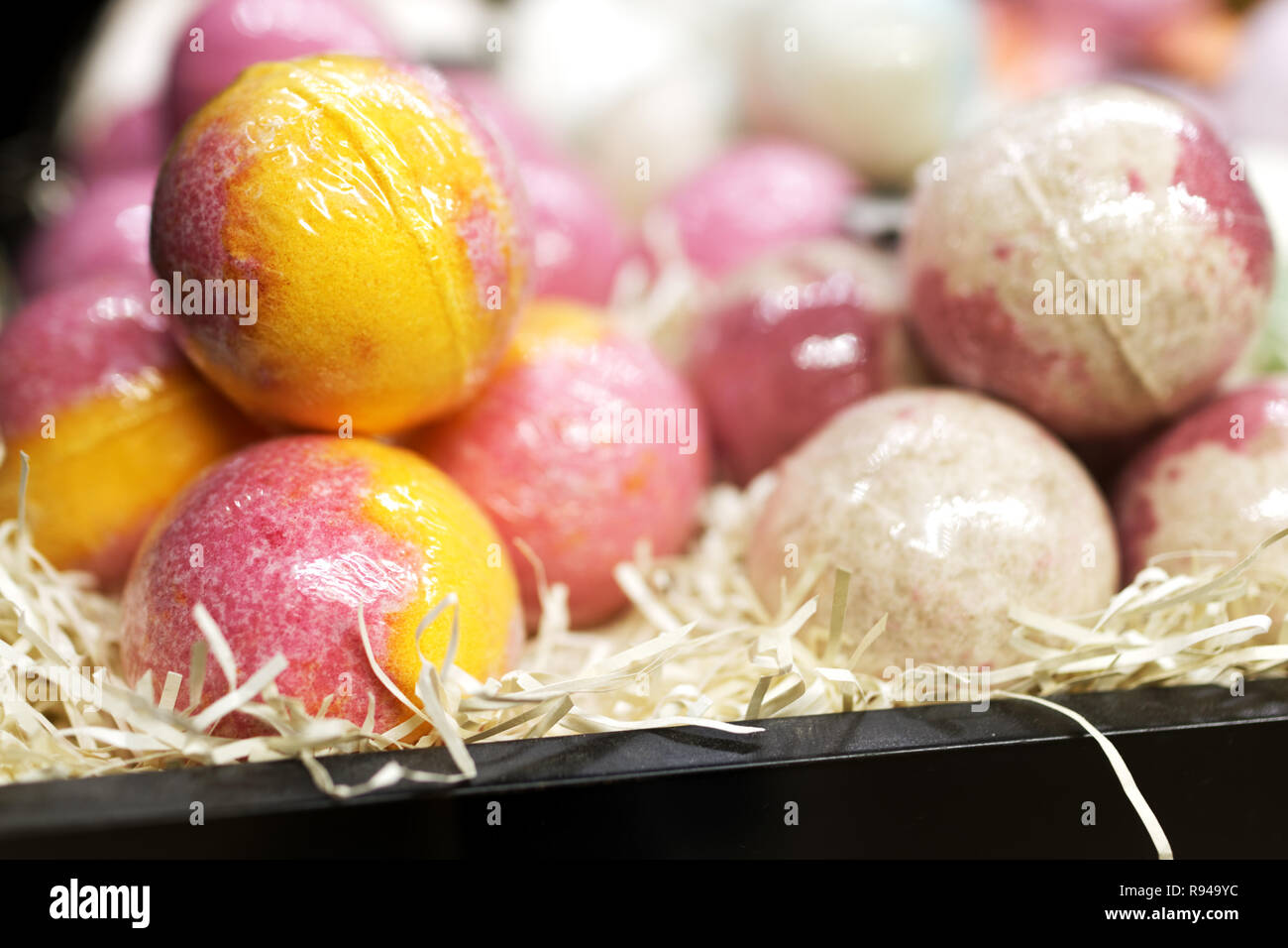 Aromatic bath bomb on a market stall. Selective focus - Stock Image