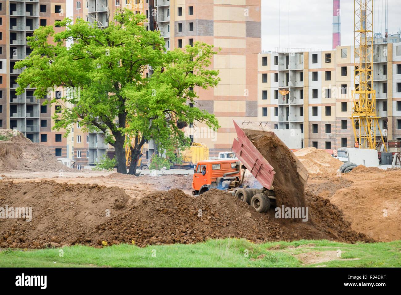 Dump truck unloads the ground. Construction site. - Stock Image