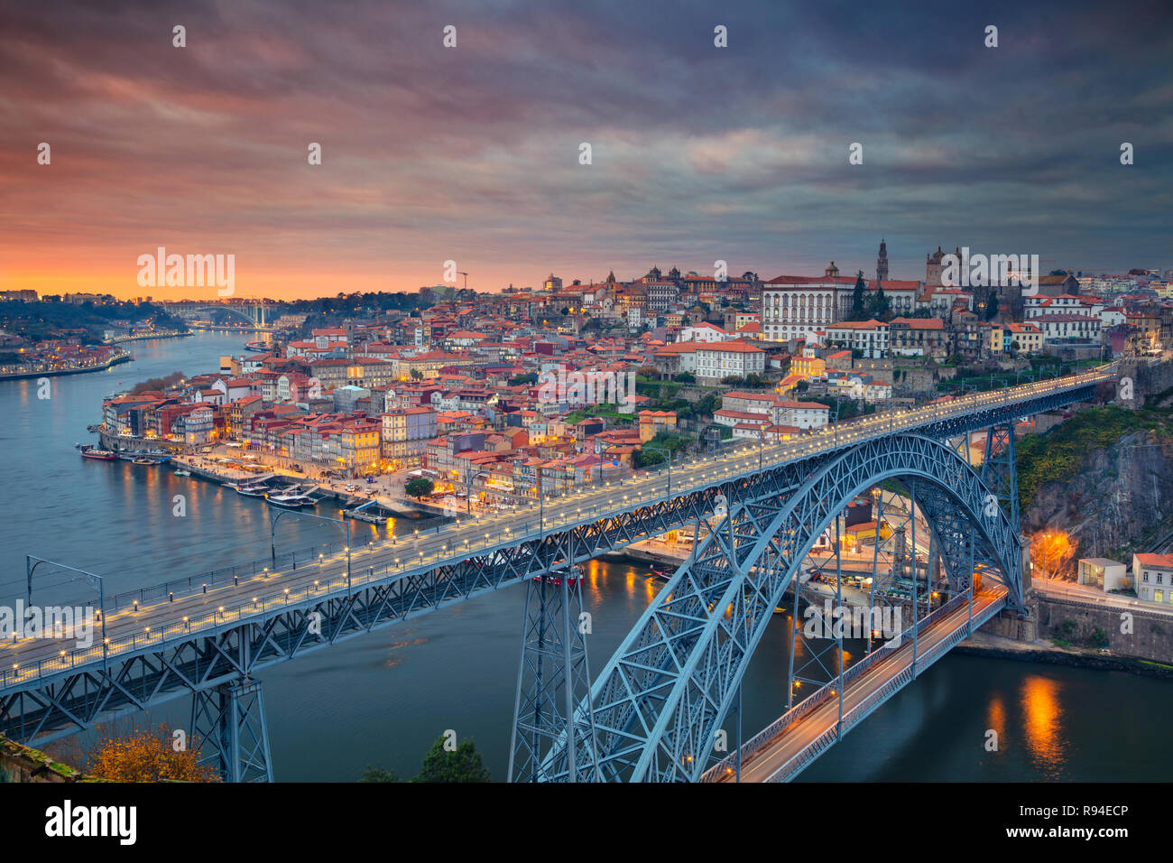 Porto, Portugal. Aerial cityscape image of Porto, Portugal with the famous Luis I Bridge and the Douro River during dramatic sunset. - Stock Image