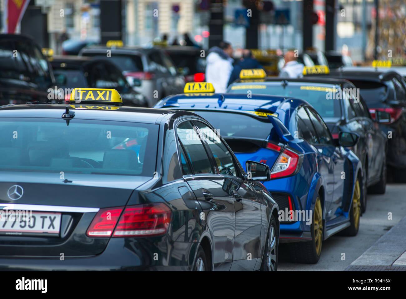 Taxi cabs at Hauptbahnhof railway station, Vienna, Austria - Stock Image