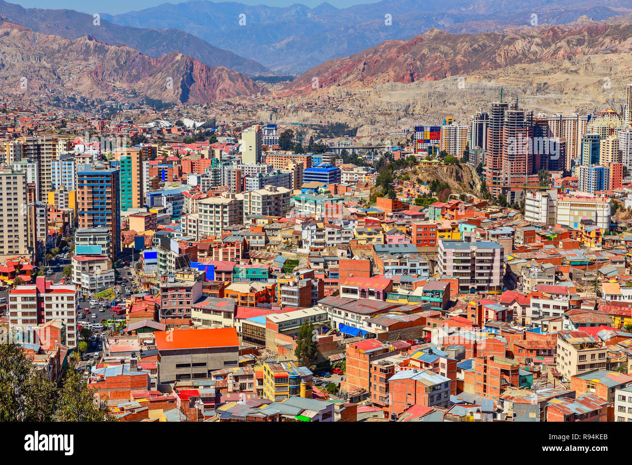 Nuestra Senora de La Paz rapidly growing colorful city suburbs with lots of living houses scattered on the hill in background, Bolivia. - Stock Image