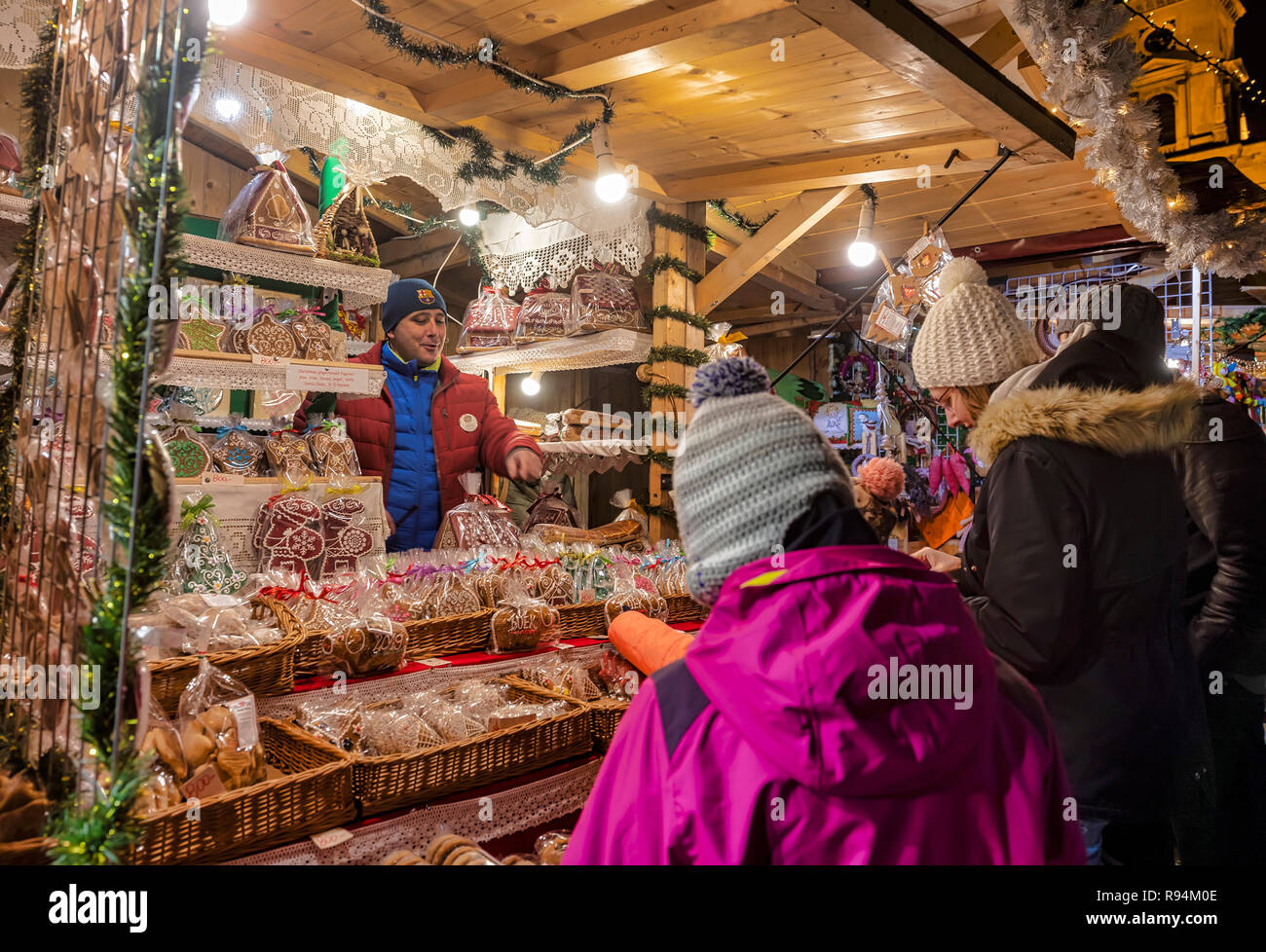 BUDAPEST, HUNGARY - DECEMBER 16: A stallkeeper offers gingerbread at the Christmas Market in front of the Szent István Bazilika (St. Stephen's Basilica) on December 16, 2018 in Budapest, Hungary. The best-known Christmas Market of Budapest is organised from year to year in front of Szent István Bazilika (St. Stephen's Basilica) at the Szent István tér (St. Stephen square). - Stock Image