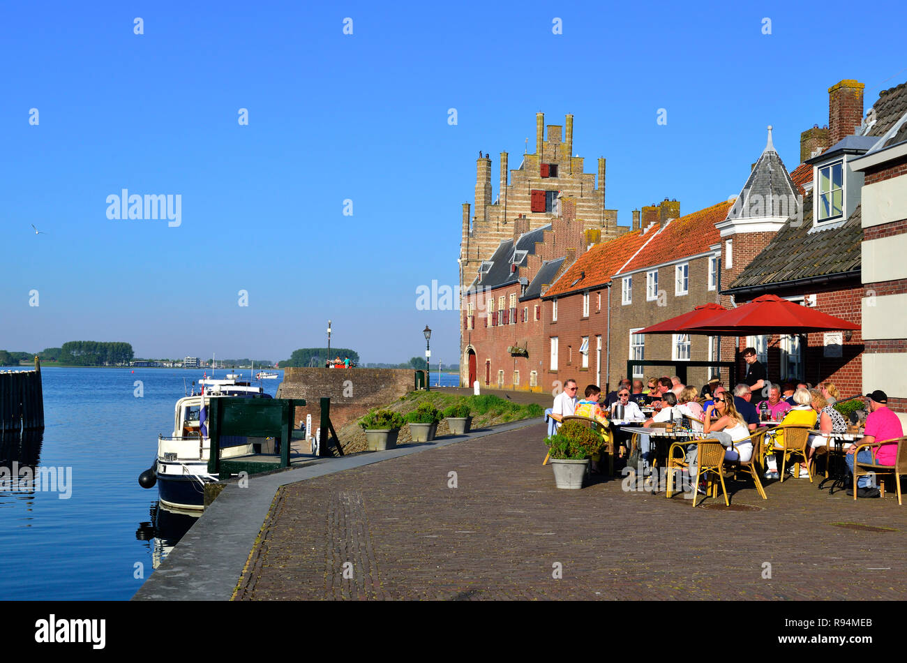 Eating alfresco in the picture postcard village of Veere a tourist town on the Veerse Meer Lake in the province of Zeeland, Holland, Netherlands Stock Photo