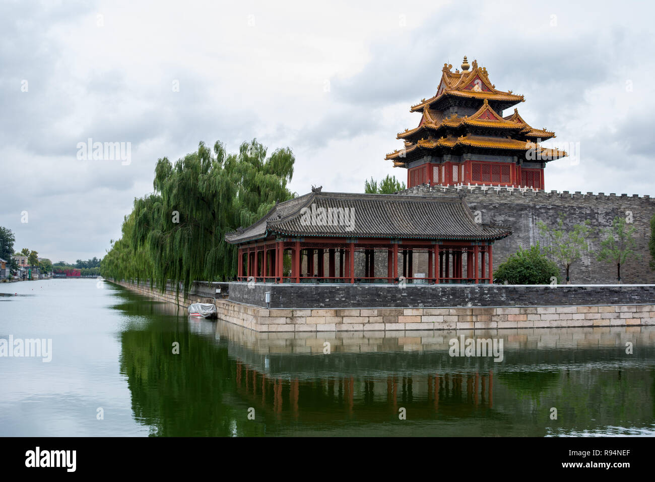Corner tower and pavilion of The Forbidden City (north east corner) showing reflections in the surrounding tongzi river, Beijing, China Stock Photo
