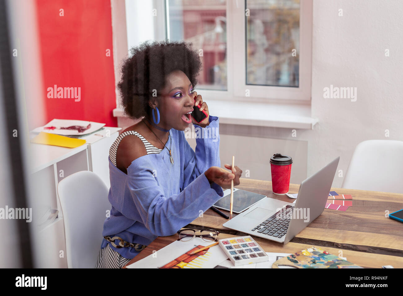 African American Interior Designer Wearing Blue Sweater Feeling Surprised Stock Photo Alamy