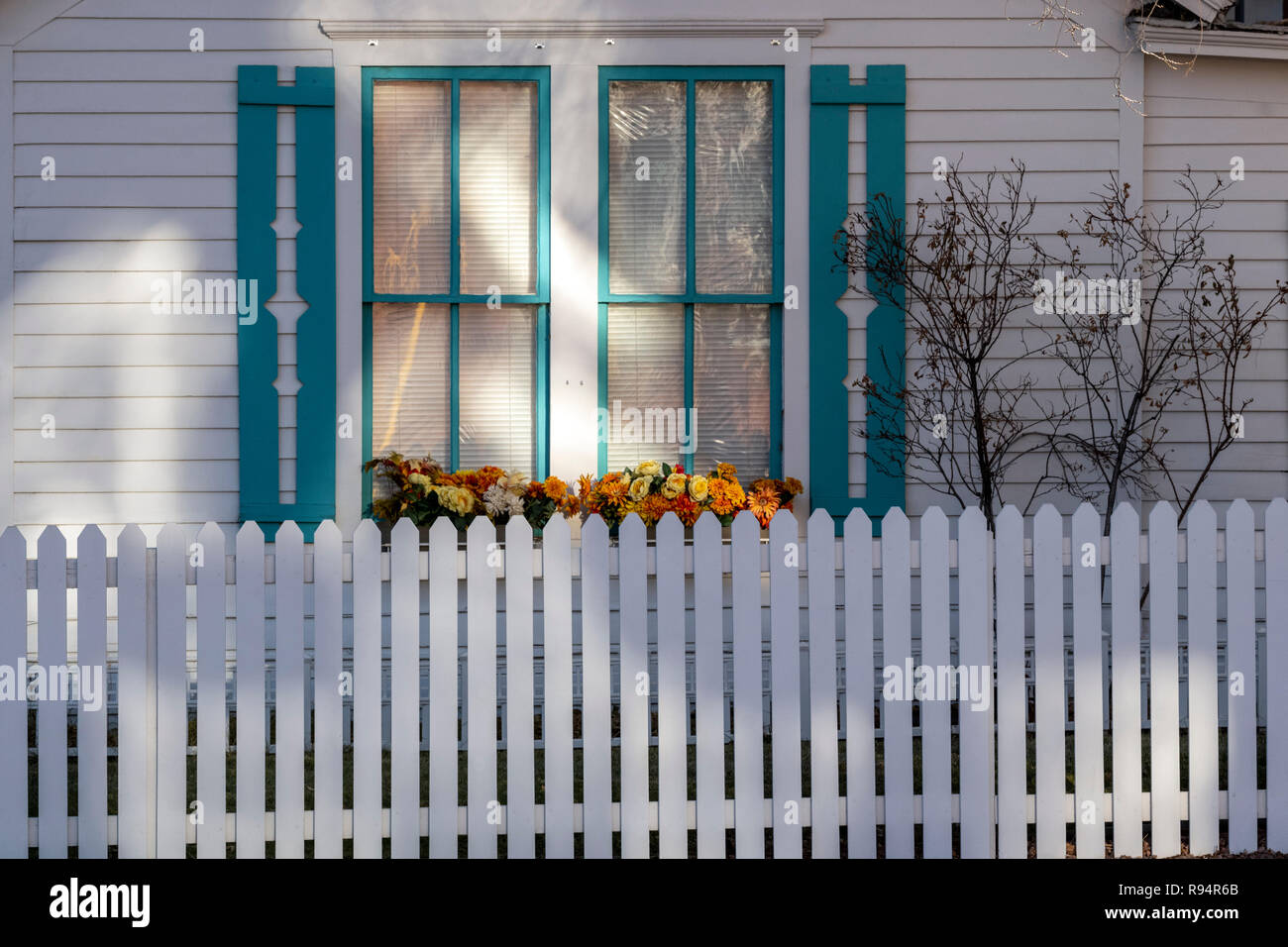 White picket fence; window & flower box; Salida; Colorado; USA Stock Photo