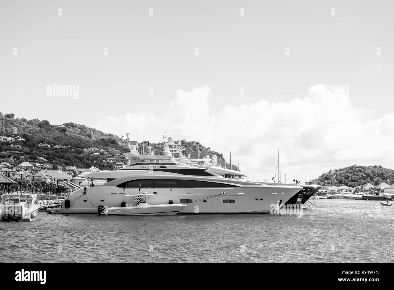 Gustavia, st.barts - January 25, 2016: yachts anchored at sea pier on tropical beach. Yachting, luxury travel on yacht. Summer vacation on island wanderlust. Water transport and vessel. - Stock Image