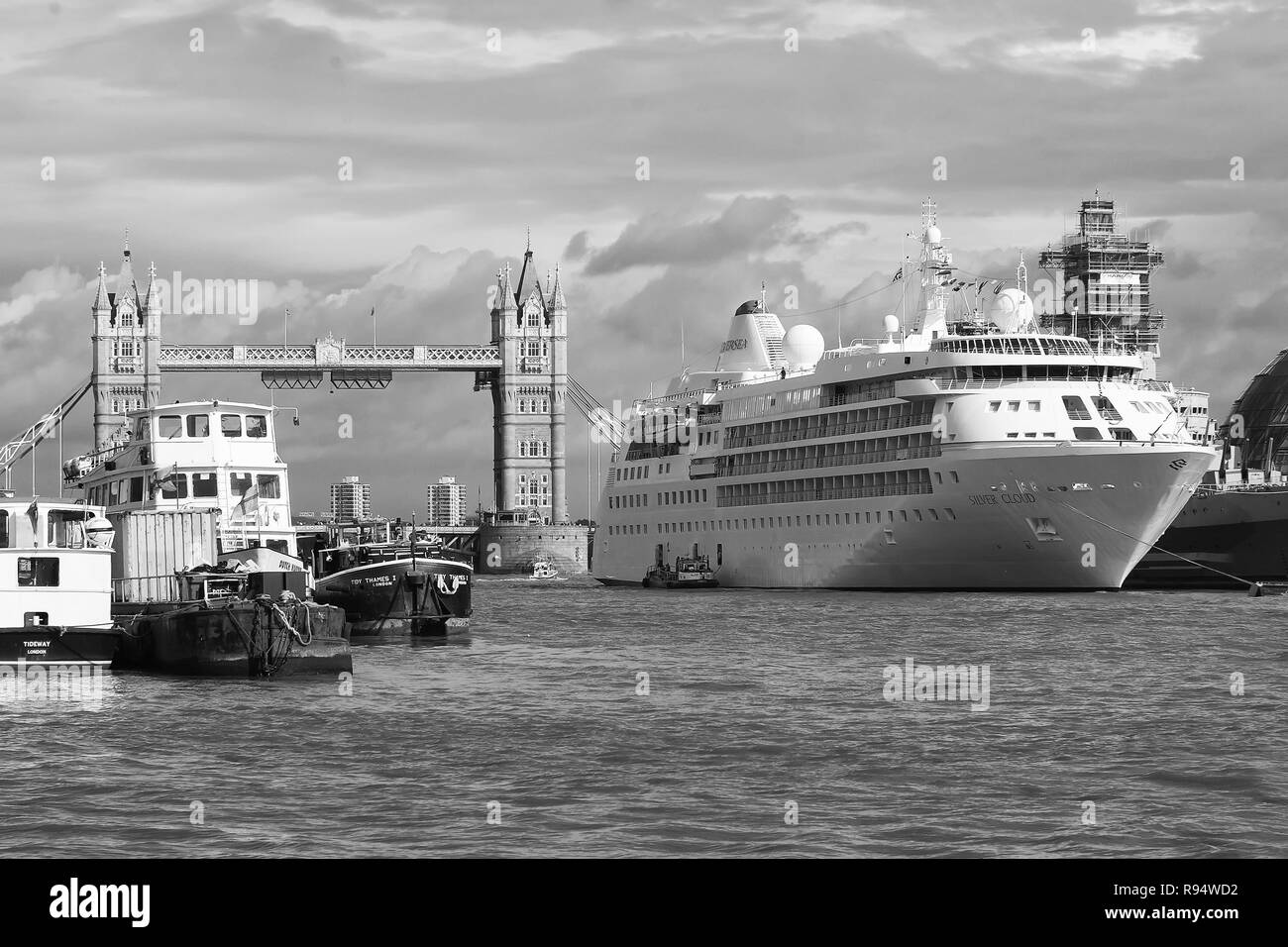 London, United Kingdom - February 25, 2010: ships on Thames river. Tower bridge on cloudy sky with nice architecture. Travelling by water. Wanderlust and adventure on summer vacation. - Stock Image