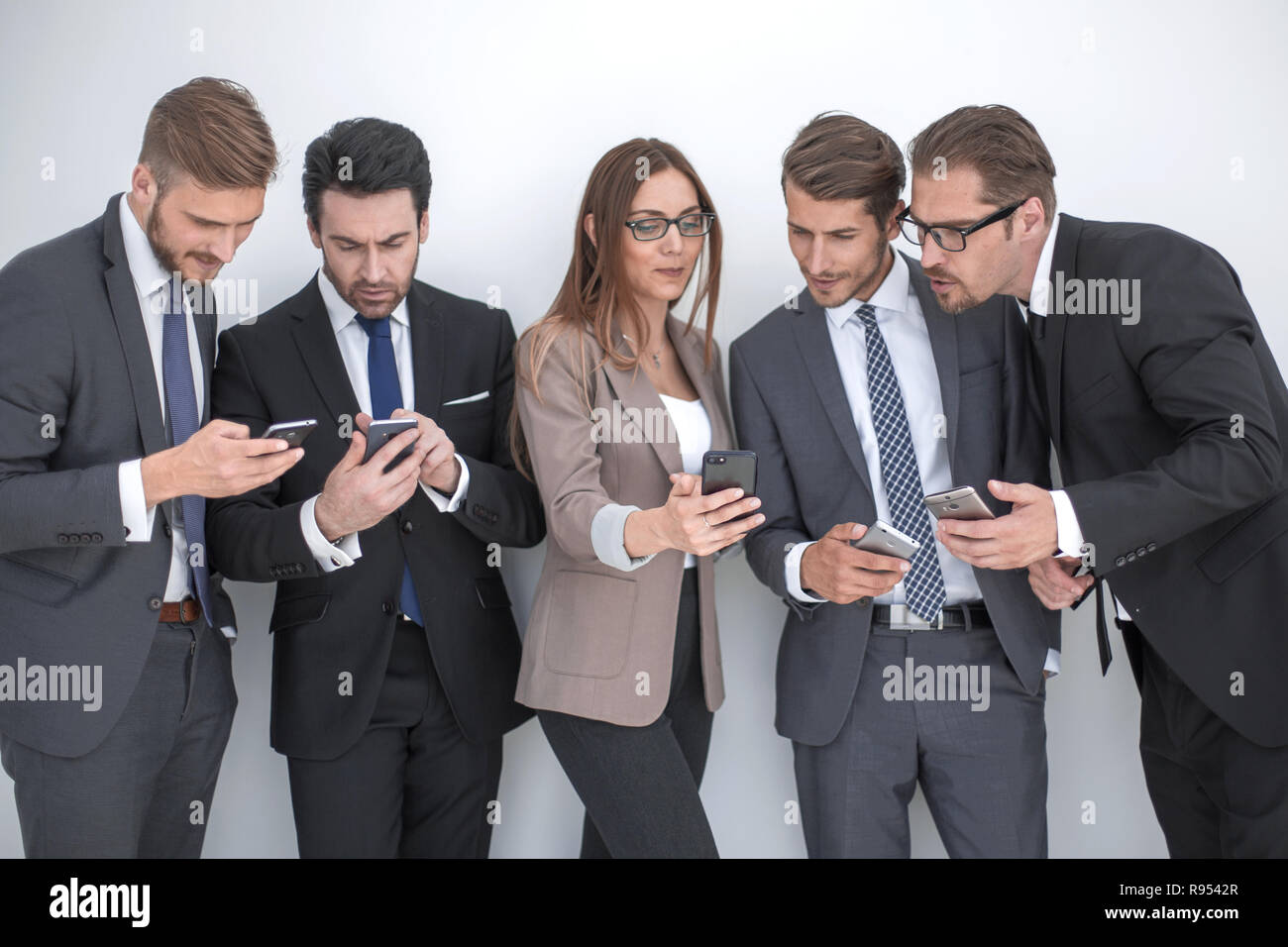 group of business people reading SMS - Stock Image
