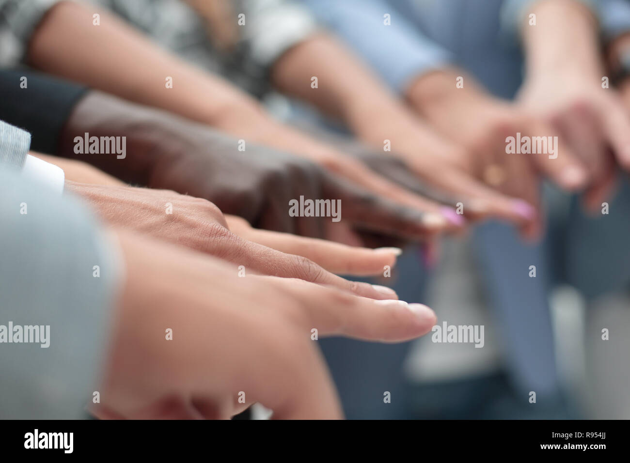 close-up of multi-racial hands - Stock Image